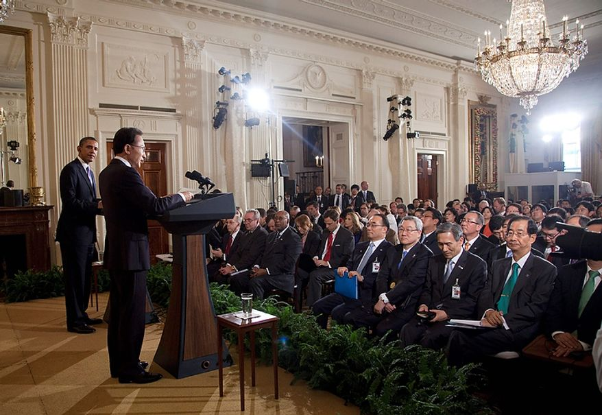 President Barack Obama and South Korean President Lee Myung-bak take part in a joint news conference, Thursday, Oct. 13, 2011, in the East Room of White House in Washington.  (AP Photo/Evan Vucci)