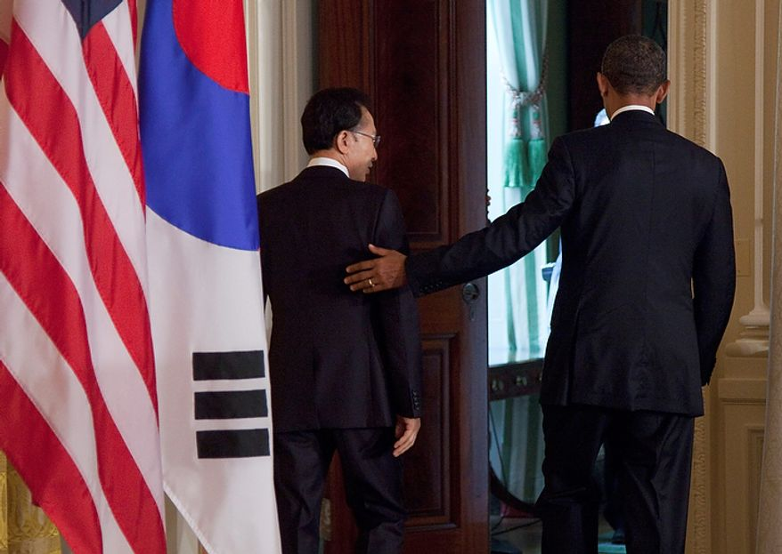 President Barack Obama and South Korean President Lee Myung-bak leave after their joint news conference, Thursday, Oct. 13, 2011, in the East Room of White House in Washington.  (AP Photo/Evan Vucci)
