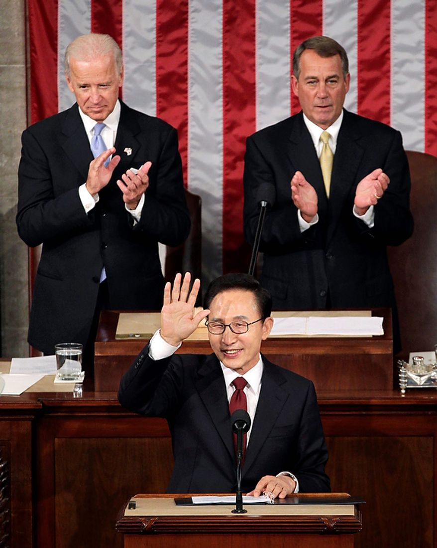 South Korean President Lee Myung-bak is applauded as he arrives to address to a joint meeting of Congress at the Capitol in Washington, Thursday, Oct. 13, 2011. Behind Lee are Vice President Joe Biden, left, and Speaker of the House John Boehner, R-Ohio, right. (AP Photo/J. Scott Applewhite)
