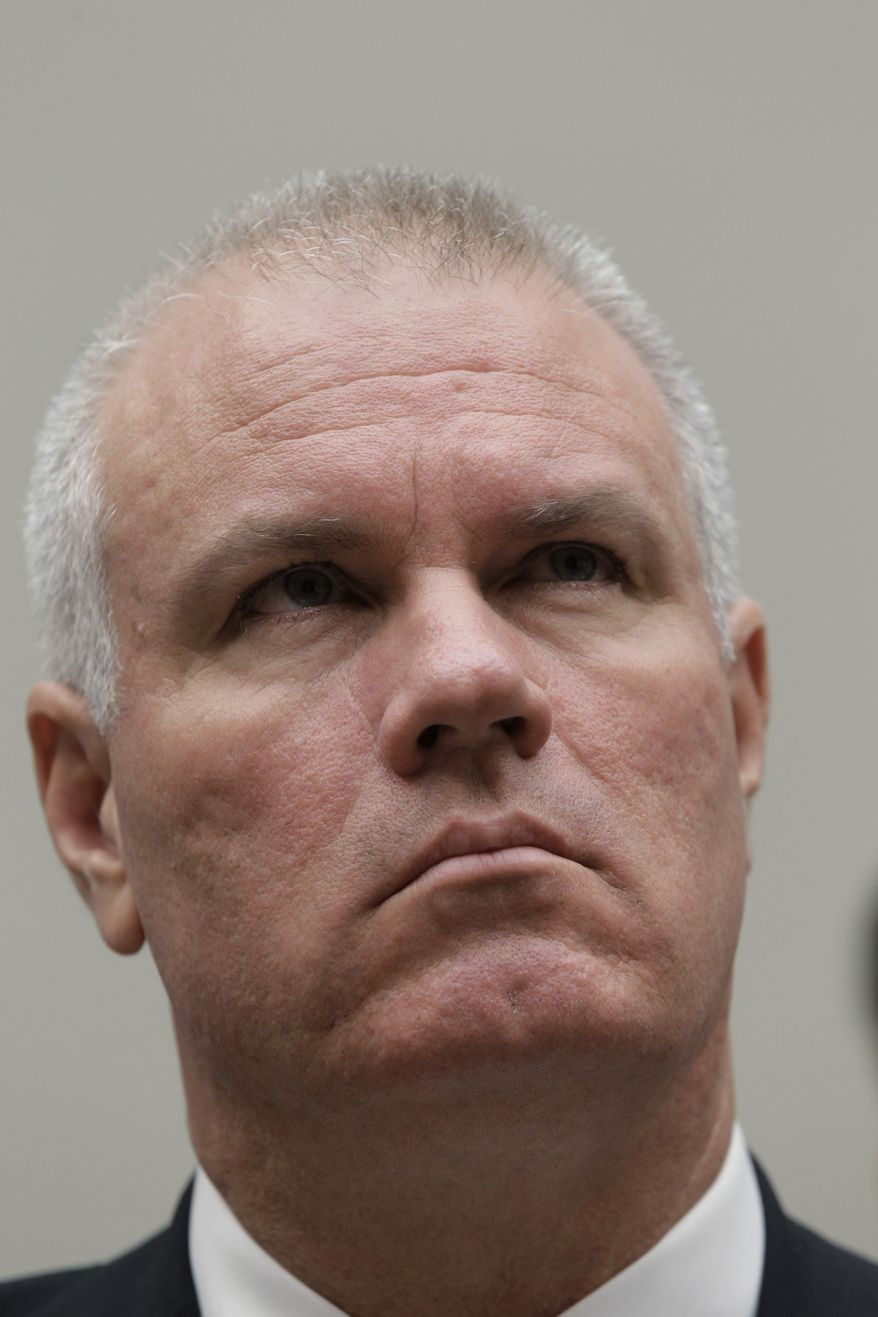 **FILE** Brian Harrison, CEO of the bankrupt solar energy company Solyndra, invokes his Fifth Amendment right to avoid self-incrimination as he appears Sept. 23, 2011, before the the House Energy Commitee's Oversight and Investigations Subcommittee. (Associated Press)