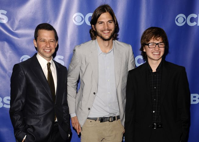 """** FILE ** In this May 18, 2011 photo, """"Two and a Half Men"""" stars, from left, Jon Cryer, Ashton Kutcher and Angus T. Jones attend the 2011 CBS Upfront party in New York. (AP Photo/Peter Kramer)"""