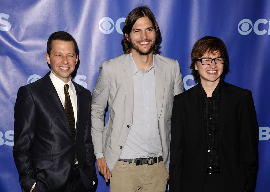 "** FILE ** In this May 18, 2011 photo, ""Two and a Half Men"" stars, from left, Jon Cryer, Ashton Kutcher and Angus T. Jones attend the 2011 CBS Upfront party in New York. (AP Photo/Peter Kramer)"