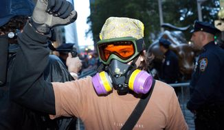 An Occupy Wall Street protestor is prepared for pepper spray and tear gas as hundreds march toward Wall Street after being heartened by the postponement of a scheduled cleanup of their camp at Zucotti Park that many protestors saw as a de facto eviction, Friday, Oct. 14, 2011, in New York. Some arrests have occurred after a few hundred protesters left Zucotti Park and marched to the area around the New York Stock Exchange. (AP Photo/John Minchillo)