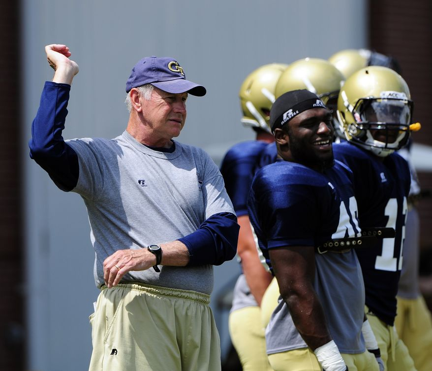 Georgia Tech defensive coordinator Al Groh stretches with members of the Yellow Jackets defense during NCAA college football practice in Atlanta. The former Virginia coach was a polarizing figure during his nine seasons trying to lead his alma mater back to football prominence, and the reception he gets when he returns as the defensive coordinator for No. 12 Georgia Tech on Saturday figures to be mixed, at best. (AP Photo/David Tulis, File)