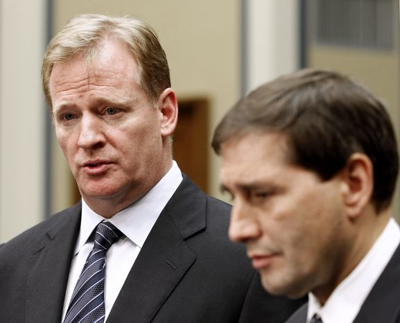 NFL football Commissioner Roger Goodell, left, accompanied by NFL lead counsel Jeff Pash speaks with reporters on Capitol Hill in Washington, Friday, Oct. 14, 2011, after meeting with Rep. Darrell Issa, R-Calif., and Rep. Elijah Cummings, D-Md. to discuss HGH testing for NFL players. (AP Photo/Haraz N. Ghanbari)