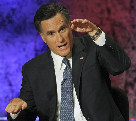 Former Massachusetts Gov. Mitt Romney makes his point during a Republican presidential debate on Oct. 11, 2011, at Dartmouth College in Hanover, N.H. (Associated Press)
