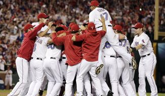 The Texas Rangers' Nelson Cruz jumps on the crowd after winning baseball's American League championship series 15-5 at Game 6 against the Detroit Tigers, Saturday, Oct. 15, 2011, in Arlington, Texas. (AP Photo/Charlie Riedel)