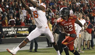 Clemson wide receiver DeAndre Hopkins makes a touchdown catch in front of Maryland defensive back Cameron Chism in the first half in College Park, Md. on Saturday, Oct. 15, 2011. (AP Photo/Patrick Semansky)