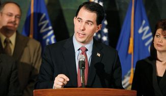 Wisconsin Gov. Scott Walker did not start paying the full cost of his pension until August, despite a campaign vow to do so upon taking office. (Associated Press)