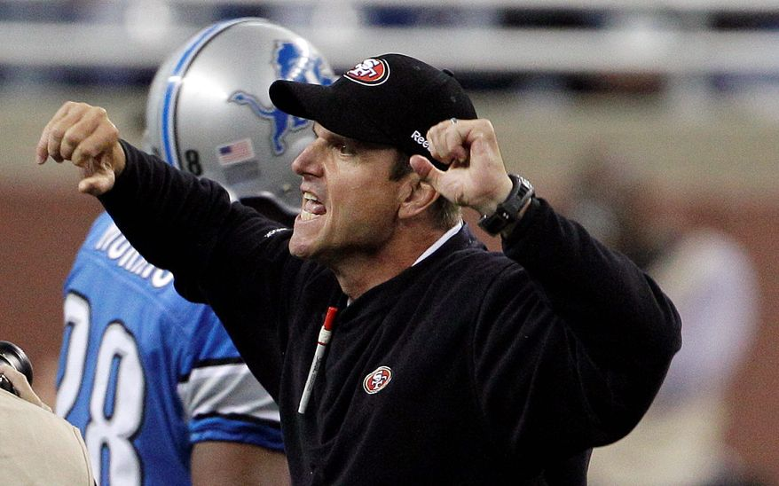 San Francisco 49ers head coach Jim Harbaugh celebrates a win over the Detroit Lions after an NFL football game in Detroit, Sunday, Oct. 16, 2011. The 49ers won 25-19. (AP Photo/Carlos Osorio)