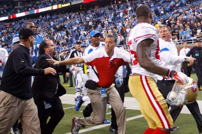 San Francisco coach Jim Harbaugh (left) and Detroit counterpart Jim Schwartz exchange heated words following the game. Harbaugh (below) exults in the 49ers' 25-19 win that knocked the Lions from the ranks of the unbeaten. (Associated Press)