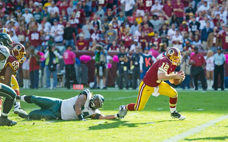 Redskins quarterback John Beck darts into the end zone from 2 yards out in the fourth quarter for Washington's only touchdown.