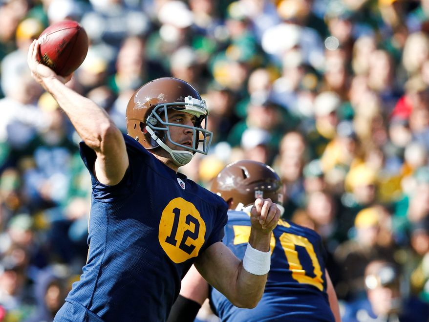 Green Bay Packers quarterback Aaron Rodgers (12) passes against the St. Louis Rams during the second half of an NFL football game Sunday, Oct. 16, 2011, in Green Bay, Wis. The Packers won 24-3. (AP Photo/Jeffrey Phelps)
