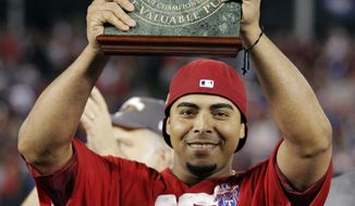 The Texas Rangers' Nelson Cruz holds the ALCS MVP trophy after hitting six home runs and driving in 13 runs (AP Photo/Charlie Riedel)