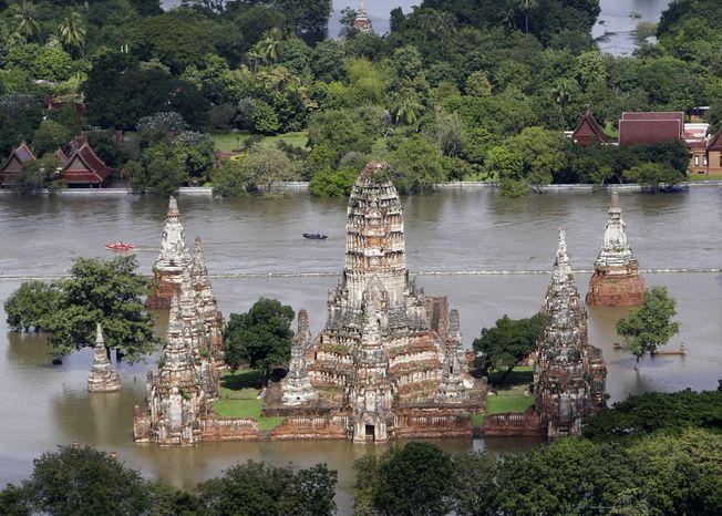 Floodwaters inundate the Wat Chaiwatthanaram temple in Ayutthaya province in central Thailand on Sunday, Oct. 16, 2011. (AP photo/Sakch