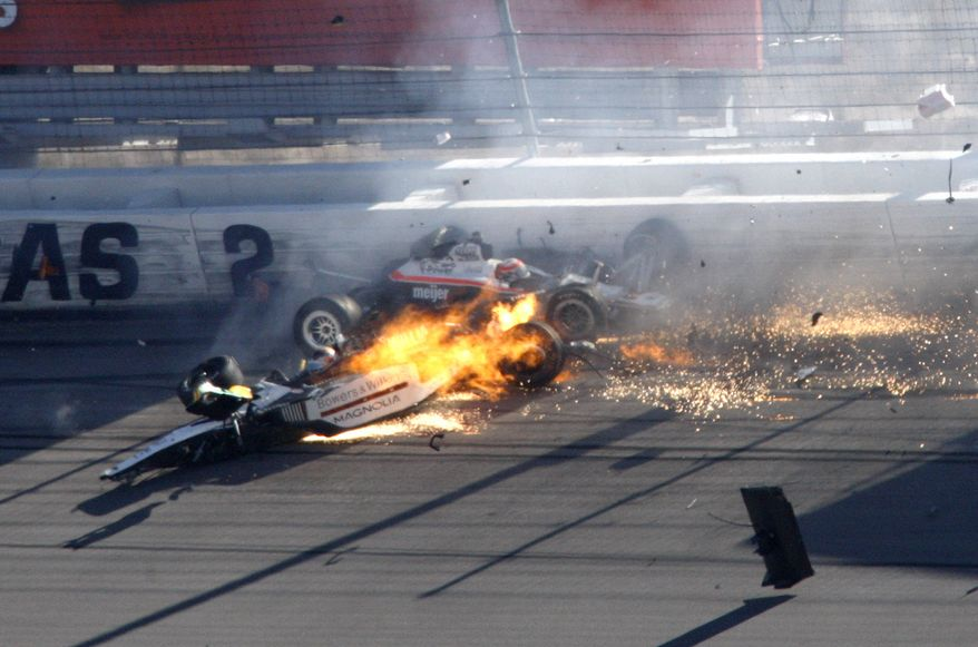 Dan Wheldon, front left, and another driver crash during a wreck that involved 15 cars during the IndyCar Series' Las Vegas Indy 300 auto race at Las Vegas Motor Speedway in Las Vegas on Sunday, Oct. 16, 2011. Wheldon died after the crash. (AP Photo/Las Vegas Review-Journal, Jessica Ebelhar)