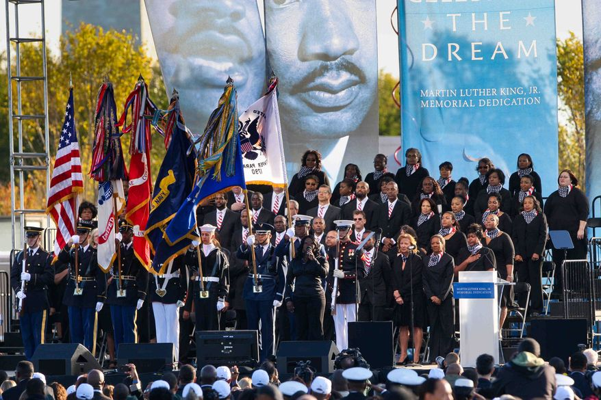 The Joint Service Color Guard presents the colors as Nova Nelson sings the national anthem at the dedication of the Martin Luther King Jr. Memorial on Sunday, Oct. 16, 2011, in Washington. (AP Photo/The News Journal, Suchat Pederson)