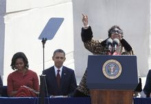 "Aretha Franklin sings ""Precious Lord"" during the dedication of the Martin Luther King Jr. Memorial in Washington on Sunday, Oct. 16, 2011. President Obama and first lady Michelle Obama are seated at left. (AP Photo/Charles Dharapak)"