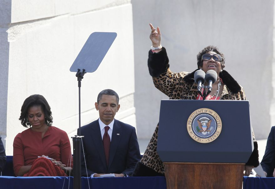 """Aretha Franklin sings """"Precious Lord"""" during the dedication of the Martin Luther King Jr. Memorial in Washington on Sunday, Oct. 16, 2011. President Obama and first lady Michelle Obama are seated at left. (AP Photo/Charles Dharapak)"""