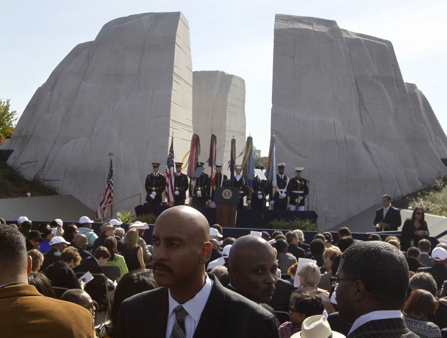 The audience awaits the arrival of President Obama to speak at the dedication of the Martin Luther King Jr. Memorial in Washington on Sunday, Oct. 16, 2011. (AP Photo/Charles Dharapak)