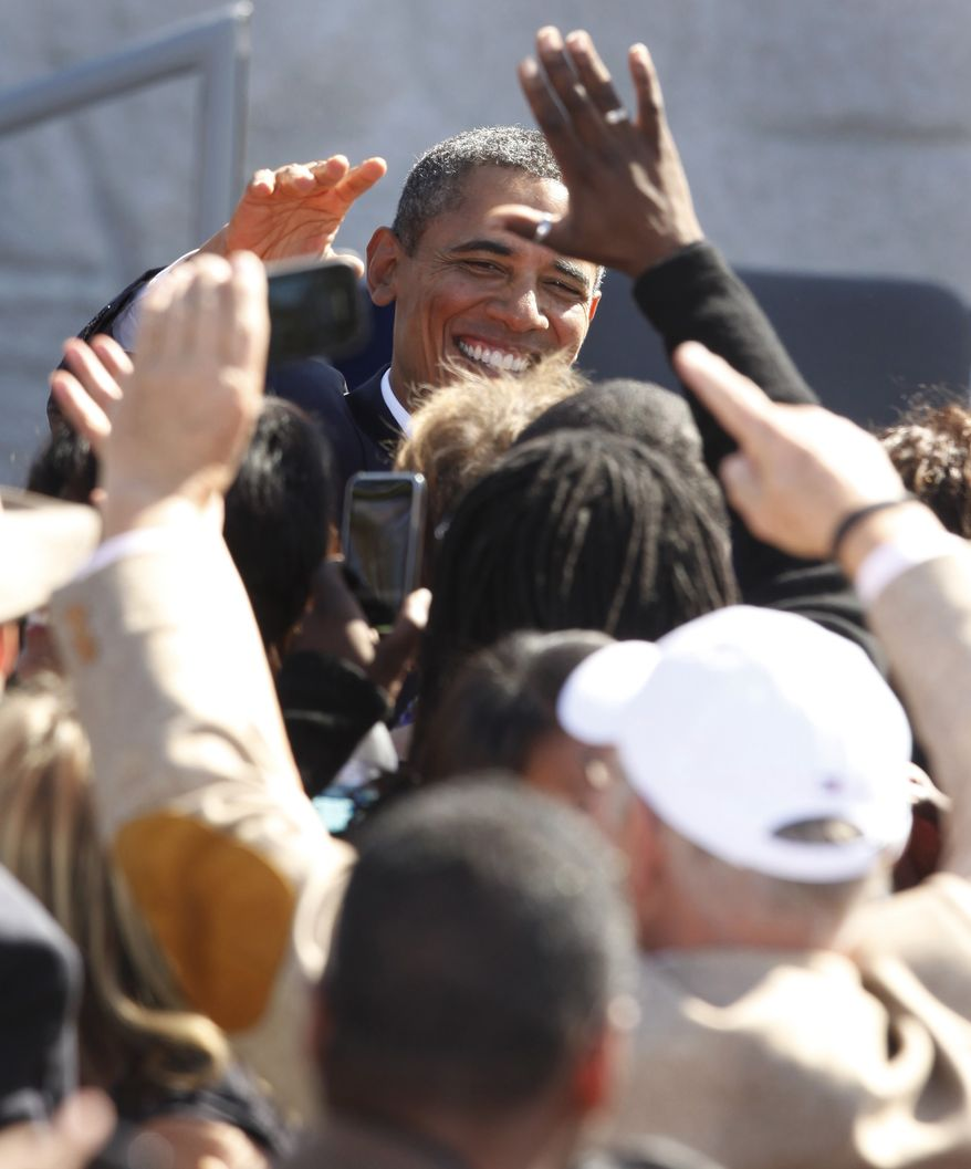 President Obama greets the audience during the dedication of the Martin Luther King Jr. Memorial in Washington on Sunday, Oct. 16, 2011. (AP Photo/Charles Dharapak)