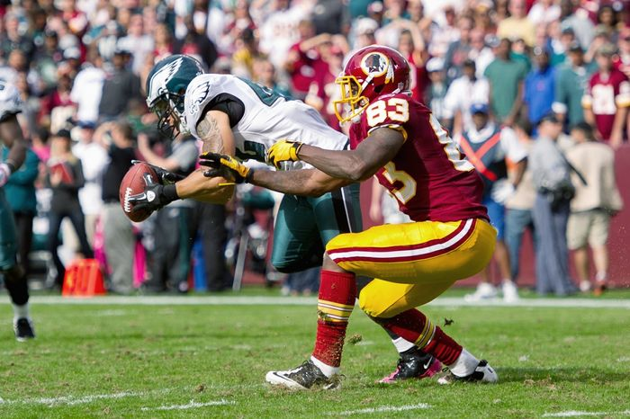 A pass intended for Washington Redskins TE Fred Davis (83) is intercepted by Philadelphia Eagles S Kurt Coleman (42) and run back 24 yards during the third quarter at FedEx Field in Landover, Md. on Sunday, Oct. 16, 2011. (Andrew Harnik / The Washington Times)