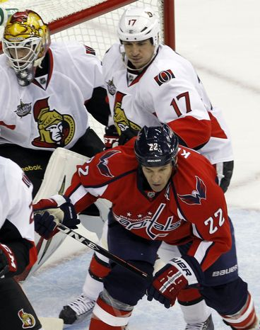 Ottawa Senators defenseman Filip Kuba tries to clear Washington Capitals right wing Mike Knuble out from in front of the net. After Sergei Gonchar went down late in the first period, the Sens played with five defensemen. The Capitals ended up the victors, winning 2-1. (AP Photo/Ann Heisenfelt)