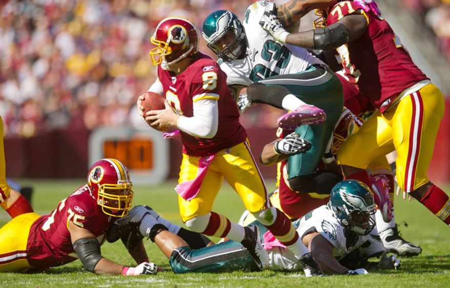 Washington Redskins quarterback Rex Grossman is pressured by the Philadelphia Eagles during the second quarter. (Andrew Harnik / The Washington Times)