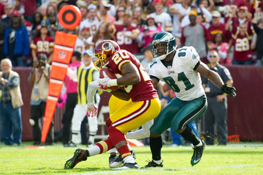 The Washington Redskins' Oshiomogho Atogwe (20) intercepts a ball on the 1-yard line from the Philadelphia Eagles during the third quarter. (Rod Lamkey Jr./The Washington Times)