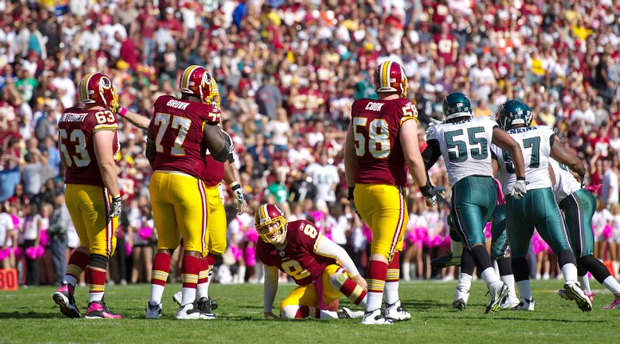 Washington Redskins quarterback Rex Grossman (8) is slow to get up after a sack for a loss of eight yards by the Philadelphia Eagles during the second quarter. (Andrew Harnik / The Washington Times)