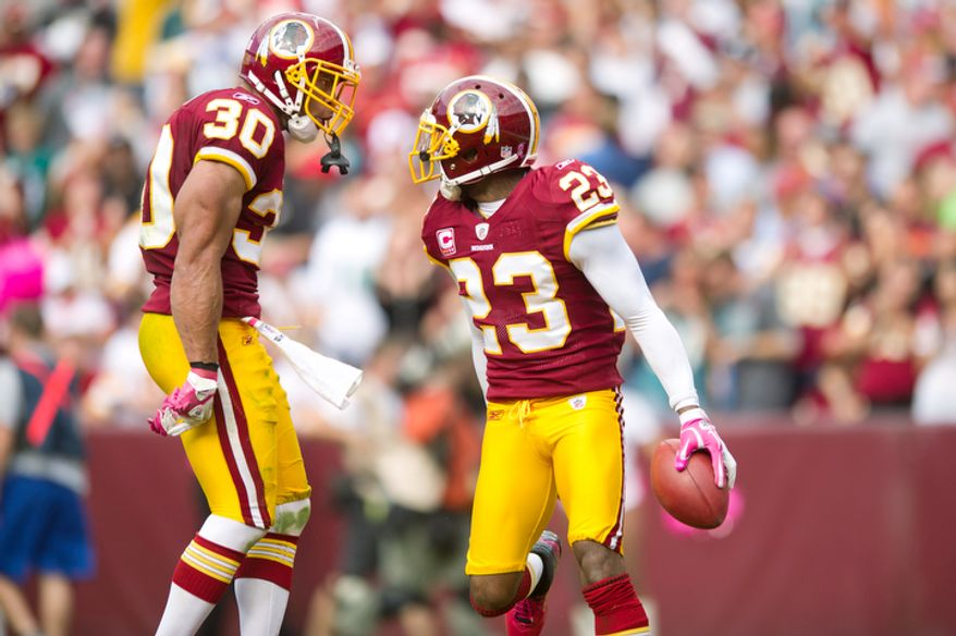 Washington Redskins DeAngelo Hall (23) celebrates with teammate LaRon Landry (30) after an interception against the Philadelphia Eagles during the third quarter. (Andrew Harnik / The Washington Times)