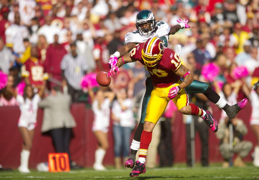 Washington Redskins Jabar Gaffney (10) can't complete a pass under pressure from Philadelphia Eagles Dominique Rodgers-Cromartie (23) during the fourth quarter. (Andrew Harnik / The Washington Times)