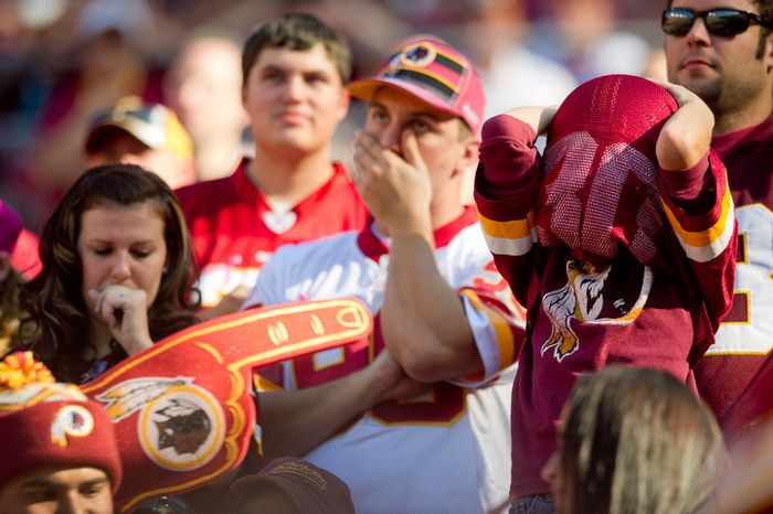 Washington Redskins fans react as their team loses 20-13 against the Philadelphia Eagles during the fourth quarter at FedEx Field in Landover, Md. Sunday, October 16, 2011. (Andrew Harnik / The Washington Times)