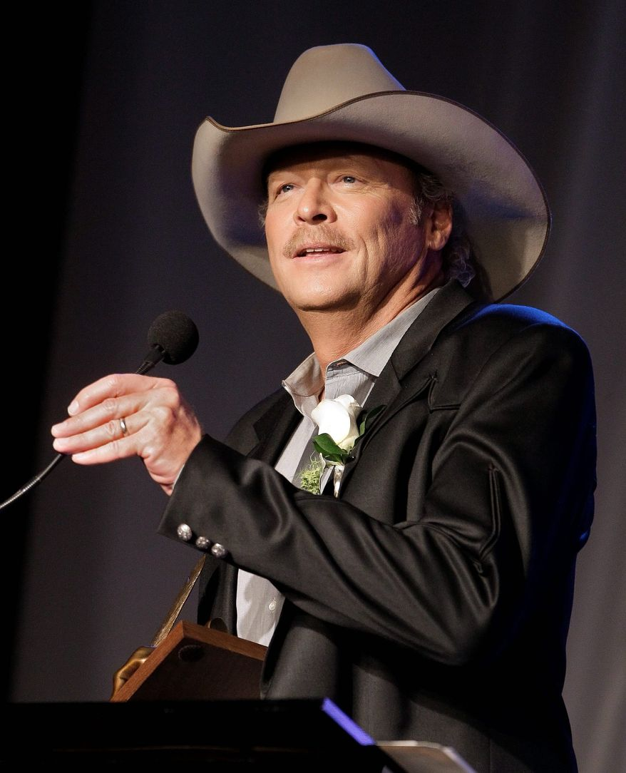 Garth Brooks and Alan Jackson (shown) are inducted into the Nashville Songwriters Hall of Fame on Sunday in Nashville, Tenn. (Associated Press)