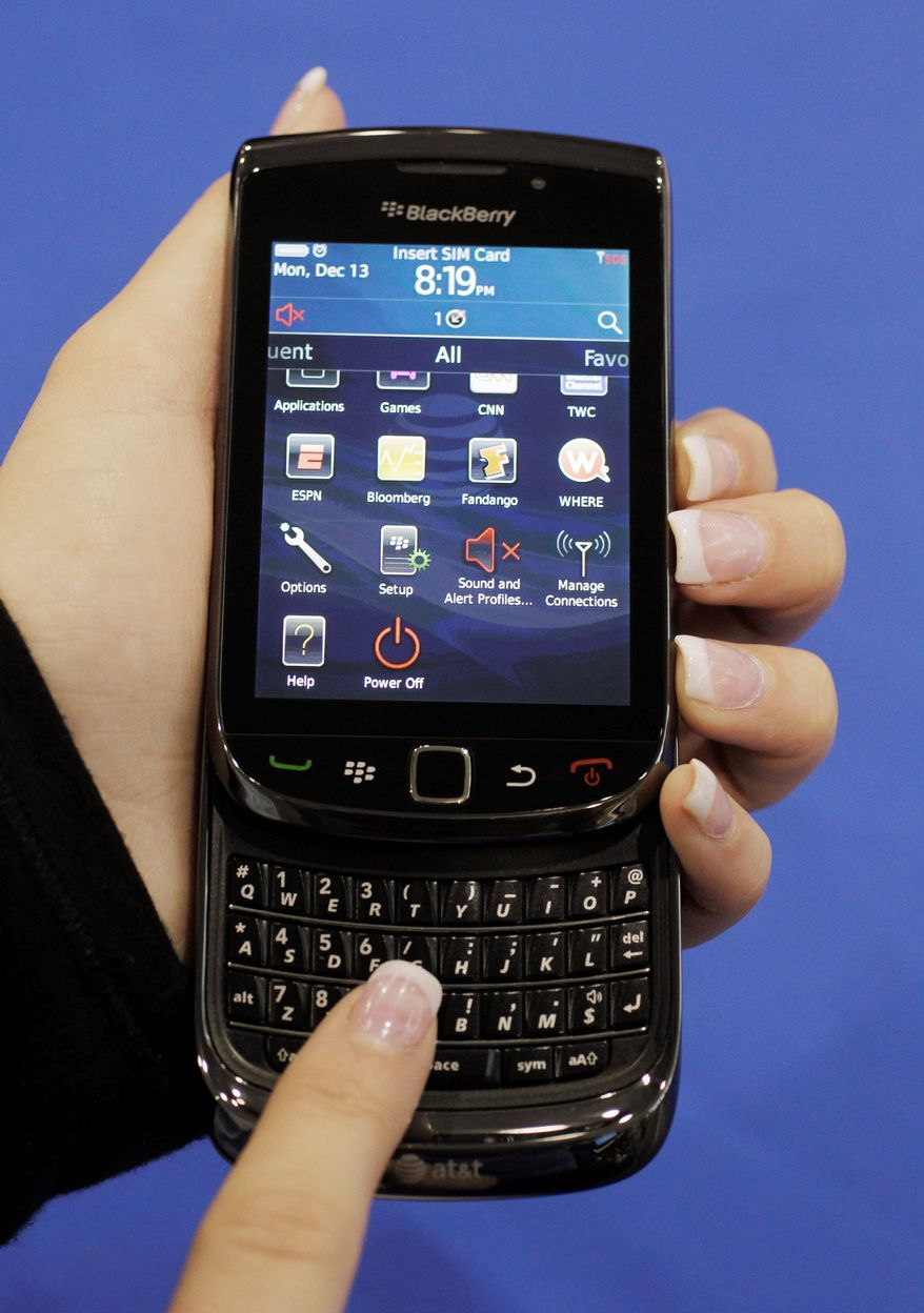 BlackBerry users are being offered free apps including iSpeech Translator, Bejeweled and Texas Hold'em after massive service outages last week. (Associated Press)
