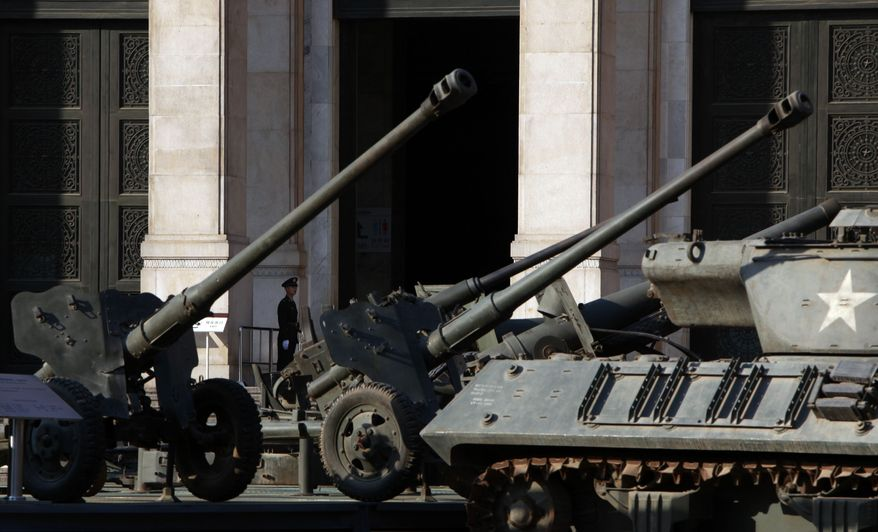 A Chinese soldier stands guard at the entrance to the military museum in Beijing on Oct. 17, 2011. (Associated Press)