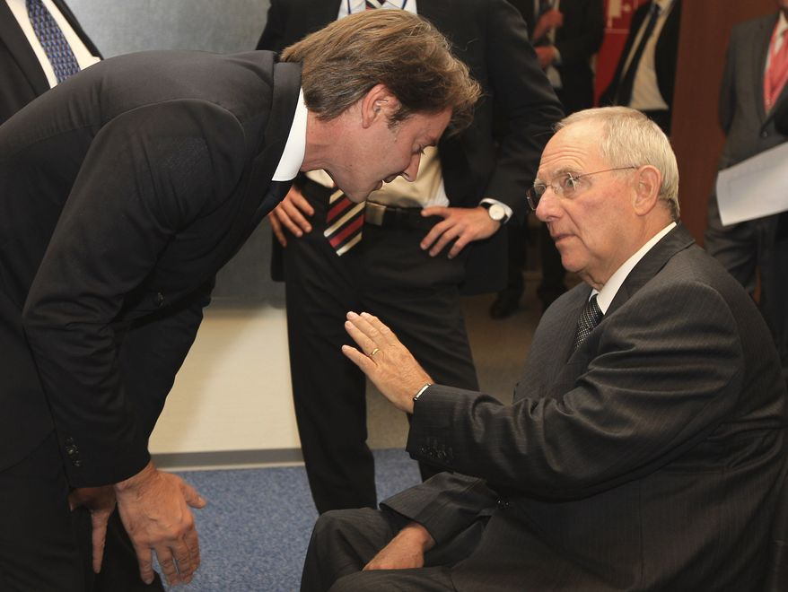 **FILE** French Finance Minister Francois Baroin (left) talks with German Finance Minister Wolfgang Schaeuble during the Eurogroup ministers meeting in Luxembourg on Oct. 3, 2011. (Associated Press)