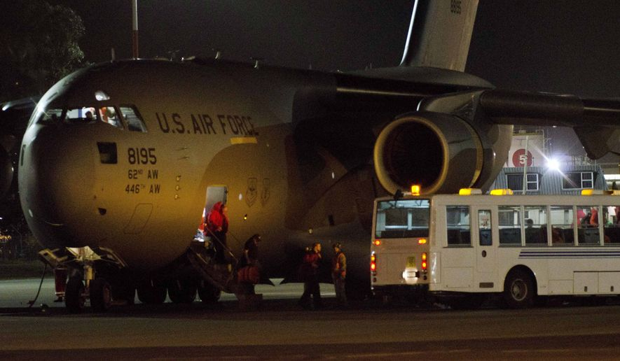 People disembark from a U.S. Air Force plane said to be carrying sick U.S. engineer Renee-Nicole Douceur, who suffered a stroke in August at the South Pole, upon the evacuation flight's arrival at Christchurch, New Zealand, on Monday, Oct. 17, 2011. (AP Photo/SNPA, David Alexander)