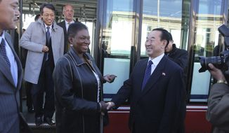 U.N. humanitarian chief Valerie Amos (center left) shakes hands with North Korean Deputy Foreign Minister Pak Kil-yon on her arrival at the Pyongyang airport on Monday, Oct. 17, 2011. (AP Photos/APTN)
