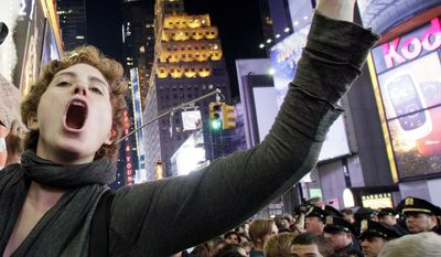 Occupy Wall Street protester Ashlie Lauren Smith, a music student from Cincinnati, screams about the $90,000 she owes in student loans at a Times Square rally on Saturday. The protests in New York and other cities have been a source of new material for comedians and satirists. (Associated Press)