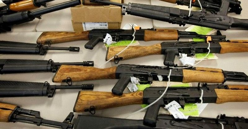 Seized weapons are displayed at a news conference in Phoenix in January. Weapons like these, which were walked into Mexico, are at the heart of the Fast and Furious investigation under way on Capitol Hill. (Associated Press)