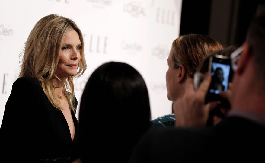 Actress Michelle Pfeiffer was among the honorees - and Barbra Streisand admirers - at the 18th annual Elle Women in Hollywood celebration on Monday. (Associated Press)