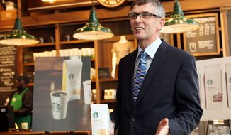 """Coffee drinkers who don't like Starbucks' dark roasts now have a """"blonde"""" lighter-roast option. Starbucks executive Cliff Burrows introduced the new roast Tuesday in New York. (Associated Press)"""