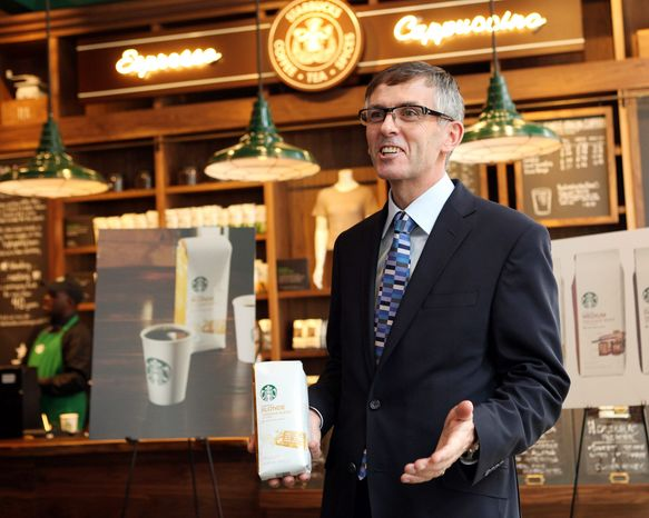 "Coffee drinkers who don't like Starbucks' dark roasts now have a ""blonde"" lighter-roast option. Starbucks executive Cliff Burrows introduced the new roast Tuesday in New York. (Associated Press)"