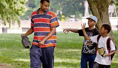 Akinlabi Mason plays catch with his two sons Elijah, 8, (right) and Paul, 9, (center) at Lincoln Park in Washington, D.C., Tuesday, June 7, 2011, before taking them off to school. Mr. Mason spends quality time with his two boys, helping to teach them the fundamentals of baseball as he shepherds them through a season of Little League and beyond. In recent years the sport of baseball is experiencing a big decline of African Americans in the game. (Rod Lamkey Jr./The Washington Times)