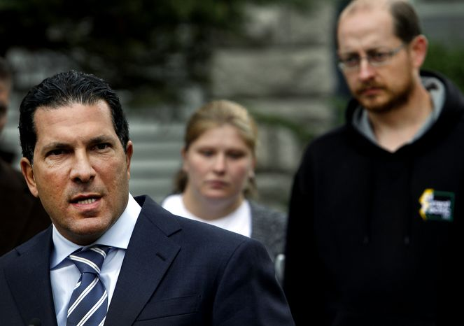 Joe Tacopina (left), the new attorney for Deborah Bradley (center) and Jeremy Irwin, whose 10-month old daughter went missing Oct. 4, speaks at a news conference on Oct. 17, 2011 in Kansas City. Tacopina is best known for defending Joran Van der Sloot, the Dutch man suspected in the 2005 disappearance of Natalee Holloway in Aruba. (Associated Press)