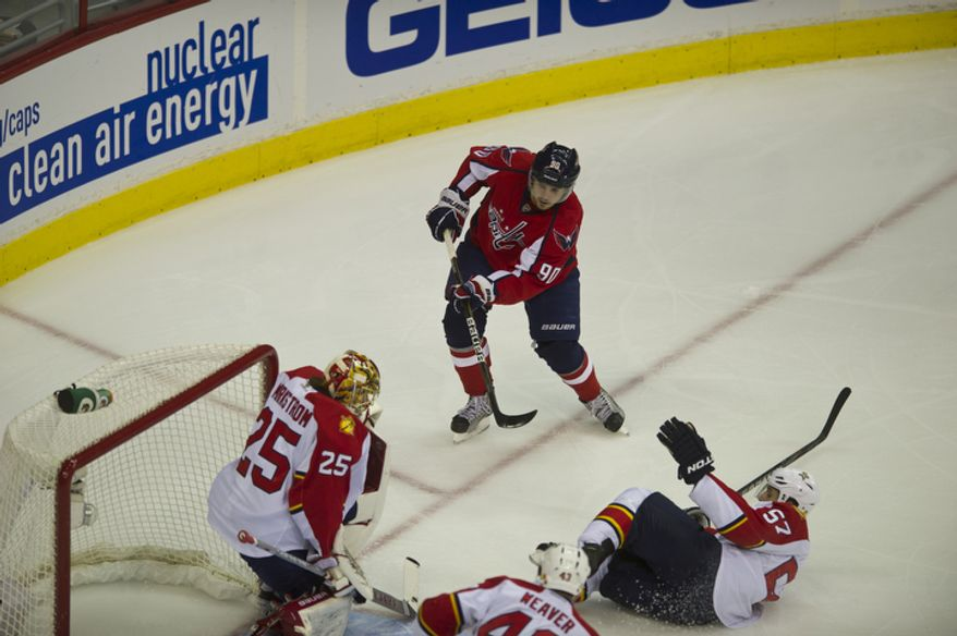 Marcus Johansson (90) of the Washington Capitals scores against the Florida Panthers in the first period as the Capitals host the Panthers at the Verizon Center in Washington,D.C., Tuesday, October 18, 2011. (Rod Lamkey Jr/The Washington Times)