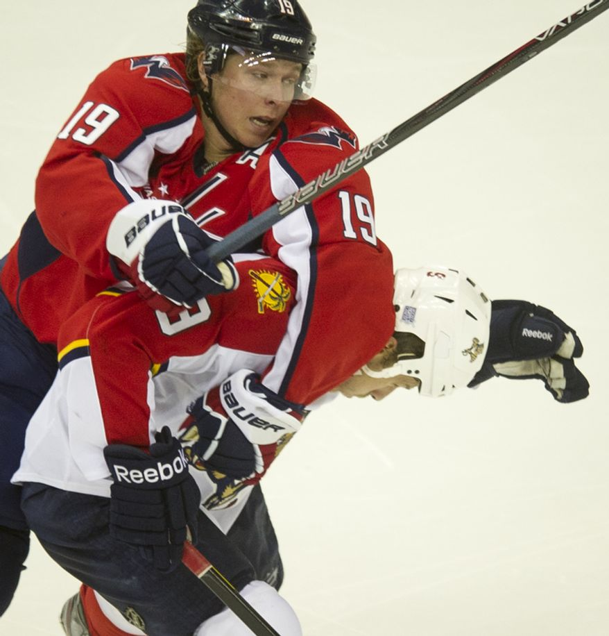 Nicklas Backstrom (19) of the Washington Capitals gets tangles up with Stephen Weiss (9) of the Florida Panthers in the second period as the Capitals host the Panthers at the Verizon Center in Washington,D.C., Tuesday, October 18, 2011. (Rod Lamkey Jr/The Washington Times)