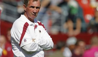 Washington Redskins head coach Mike Shanahan watches his team warm up before a NFL football game against the Philadelphia Eagles in Landover, Md., Sunday, Oct. 16, 2011. (AP Photo/Evan Vucci)