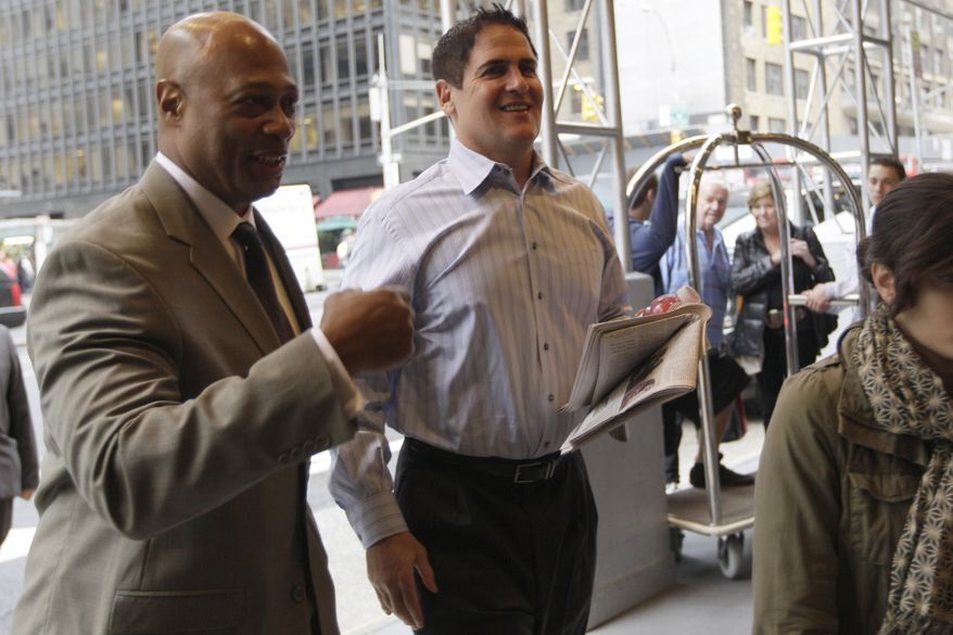 Dallas Mavericks owner Mark Cuban, right, arrives for labor talks between the NBA and players' association, Tuesday, Oct. 18, 2011 in New York. (AP Photo/Mary Altaffer)